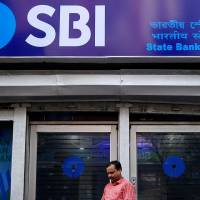 SBI share price gains 2% ahead of June quarter results; brokerages see improvement in asset quality