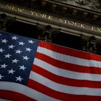 Wall Street opens slightly lower; fresh stimulus awaited