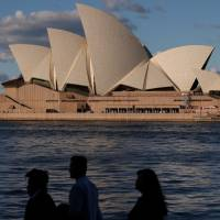 Australia unlikely to fully reopen borders in 2021 as COVID-19 cases slide