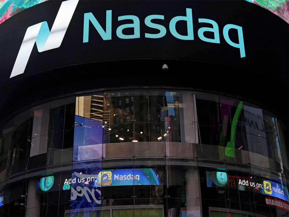 Nasdaq hits record high at the open as Biden takes office; Netflix soars