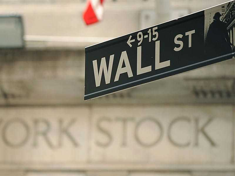 Wall Street closes on a mixed note, dollar advances on COVID-19 concerns