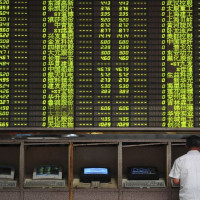 Asian shares nudge higher in defensive trade, dollar soft