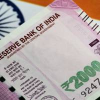 Rupee zooms 65 paise to close at 72.72 against US dollar