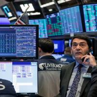 Nasdaq hits correction, Dow advances as stimulus bill nears finish line