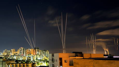 WATCH: Iron Dome intercepts massive missile salvos from Gaza as sirens blare in Tel Aviv